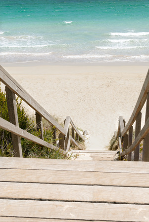 Wooden stairs leading to a beach of the Indian Ocean