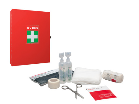 emergency kit: First aid box white cross symbol and medical supplies isolated on a white background. Stock Photo