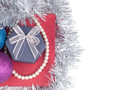 Christmas decorations and gifts on a glossy surface isolated on a white background.
