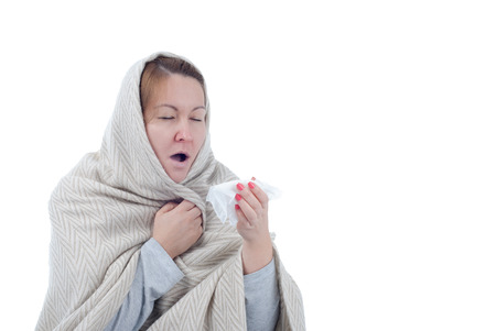 Sick woman sneezing holding white tissue isolated on a white background. Standard-Bild