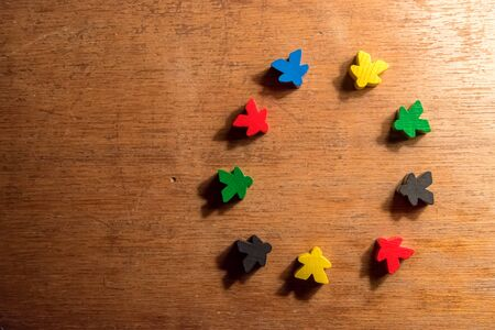 Small human shaped colored wooden pieces