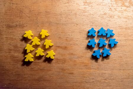 Two teams - Small human shaped colored wooden pieces