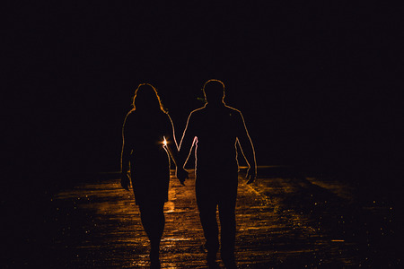 headlights: Silhouette couples in the headlights Stock Photo