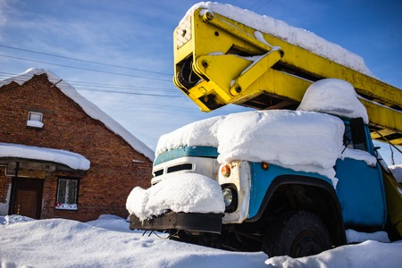 frost bound: Car tower covered in several inches of snow Stock Photo