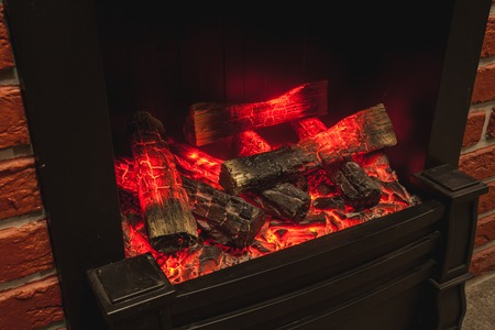 woodburner: the real fireplace with the burning firewood and coal Stock Photo