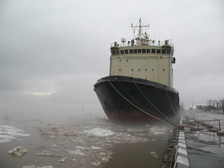 forepart: Icebreaker moored on the bay. Nose of ship. Ice drift. Stock Photo
