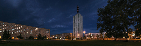 crepuscle: Arkhangelsk, Russia, blue evening  in central square.  High-rise building on background. Street illumination. Panorama. Stock Photo