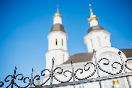 love dome: the fence and church on background bokeh.