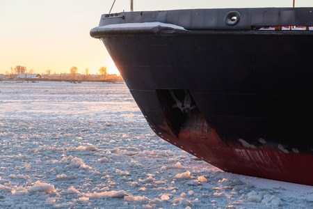 Icebreaker in the river ice. Nose of ship