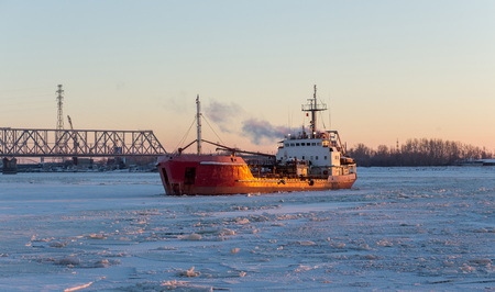 Icebreaker in the river ice. Panoramic view Stock Photo