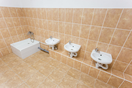Clean Children Washroom With Sinks And Water Closet In Kindergarten. Stock  Photo   70099155