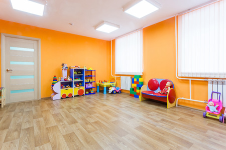Bright orange game room in the kindergarten.
