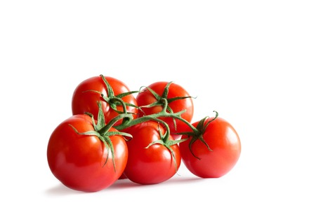 Cluster of fresh red tomatoes on isolated white backround. Stock Photo