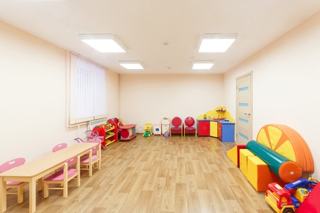Spacious light pink colored game room with in the kindergarten