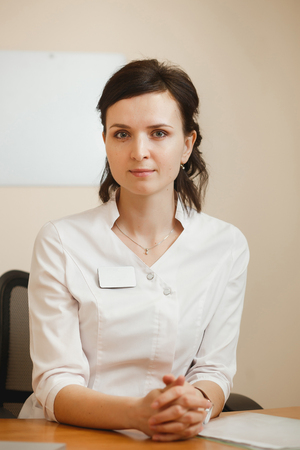 Attractive female doctor ophthalmologist keeping an appointment in ophthalmology clinic