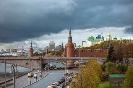 View of the kremlins part in and the Great zamoskvoretsky bridge with traffic from cars in cloudy weather
