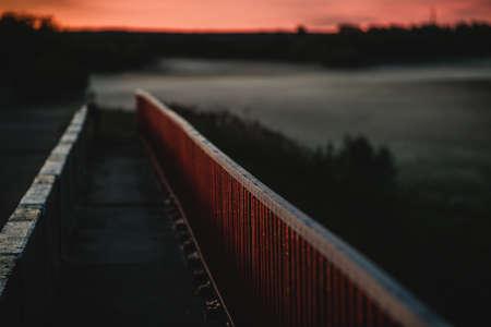 Red bridge railings on a summer night 免版税图像