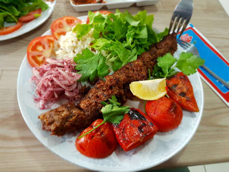 Plate of Adana Kebab a typical turkish meat dish in the street restaurant