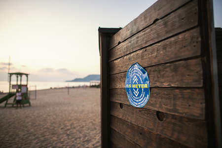 Alanya, Turkey - November 2020: Blue warning sign on the beach in the Turkey with text 1.5 meter afstand that means Keep distance 1.5 meters
