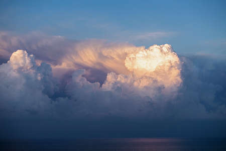 Cumulus storm clouds over the sea, weather forecast, atmospheric front 免版税图像