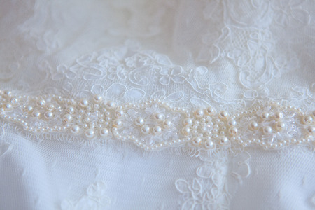 details: Details of the wedding dress, stitch with pearls and beads