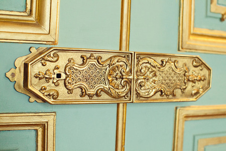 korean style house: trim on the doors, the handle decorated with monograms and gold Stock Photo