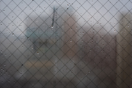 blurr: Close up of wet glass with blurr city background