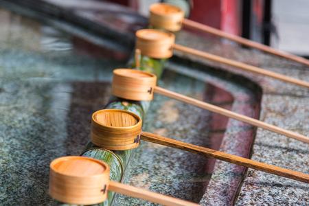 Close up of japanese wooden ladle in shrine yufuin kyushu japan.