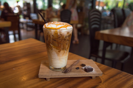 Close up of ice coffee with whip cream and caramel on top in cafe  tokyo japan. Stock Photo - 55496102