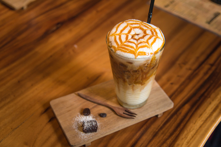Close up of ice coffee with whip cream and caramel on top in cafe  tokyo japan.