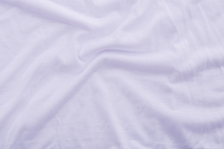 cotton fabric: Close up of beautiful wrinkle white color bedsheet fabric texture.