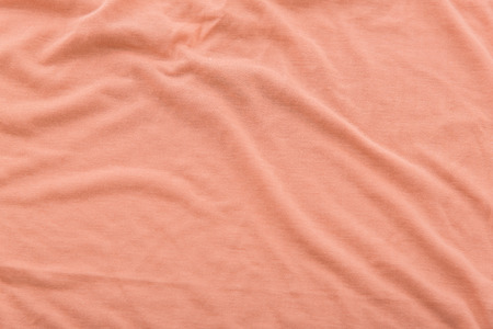 bedsheet: Close up of beautiful wrinkle coral color bedsheet fabric texture. Stock Photo