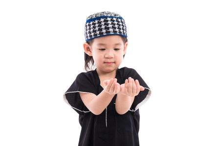 namaz: Close up of cute muslim boy on white background isolated.