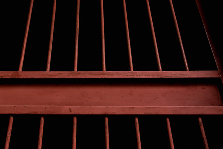 gaol: Close up of old rusty iron bar in jail. Stock Photo