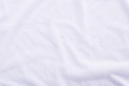 bedsheet: Close up of wrinkled white bedsheet texture background.