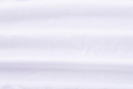 Close-up van gerimpelde witte laken textuur achtergrond.