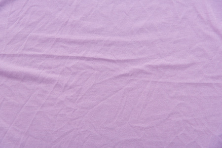 bed sheet: Close up of violet wrinkled bed sheet textured. Stock Photo