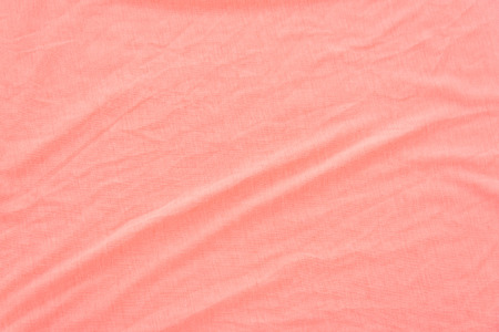 bed sheet: Close up of coral wrinkled bed sheet textured background. Stock Photo