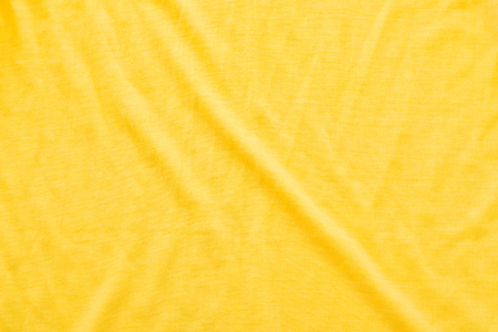 bed sheet: Close up of yellow wrinkled bed sheet textured background.