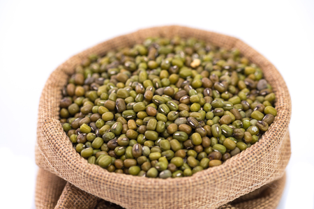 black gram: Close up o mung bean in sack bag on white background isolated.