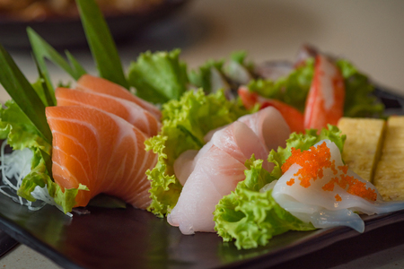 restuarant: Close up of japanse food call sashimi made from fresh seafood in local japanese restuarant tokyo japan.