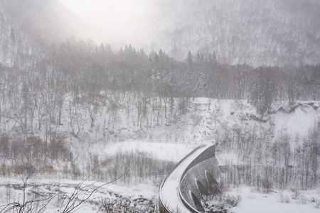Beautiful stone bridge cover by snowand sunlight  in winter okuhida takayama Japan.