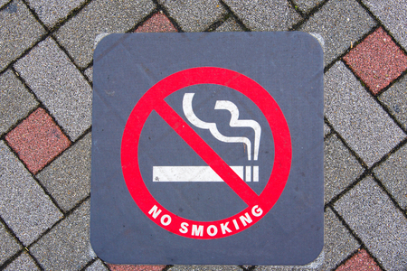 dont walk: Close up of no smoking sign on the ground in Japan.