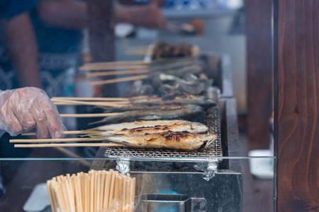 Close up of Japan local fish called ayu sprinkled with salt   grilled on charcoal Oita Japan. Stock Photo