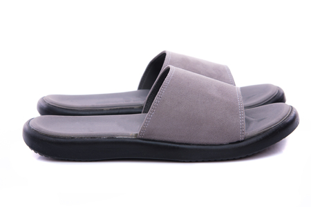 Close up of grey leather sandal on white background solated. Stock Photo