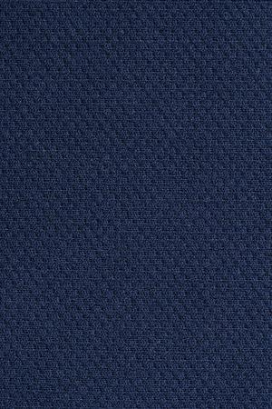 Close up of dark blue wrinkled bedsheet fabric textured background. Stock Photo