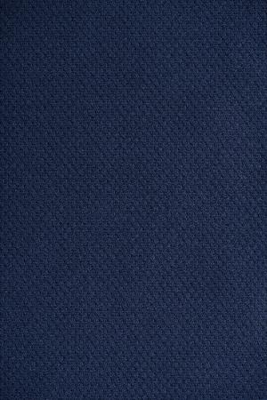 bedsheet: Close up of dark blue wrinkled bedsheet fabric textured background. Stock Photo