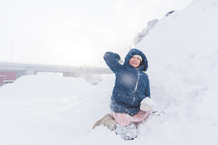 Close up of cute happy asian girl playing snow in winter Aomori Japan.