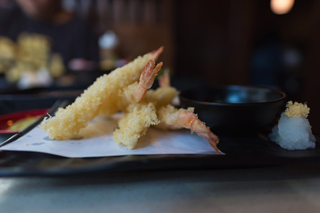 Cllose up of japan local food called tempura contain with shrimp flour and spice.
