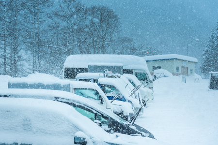 Vechiles cover by snow at car park in winter Japan. Stock Photo